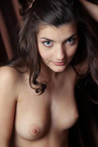 Ryanel A is naked on floor showing off her perfectly shaped breasts