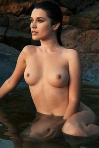 Posing on the beach does not stop Serena Wood from going completely nude