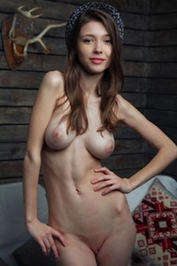 Gorgeous young brunette shows no fear as she cups her perfect breasts