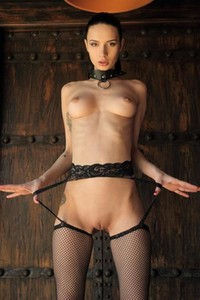 Dita V submits in her black collar and her sexy fishnet stockings
