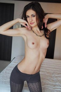 Lilian A slips down her leggings and gently pleasures herself in bed