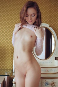 Cathleen A spreads herself with her fingers in front of the mirror