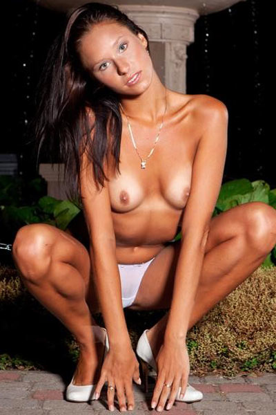 Diala in white bra and panties modeling in nighttime botanic garden