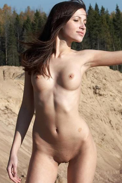 Masha strolling completely nude along the sand is erotic vision