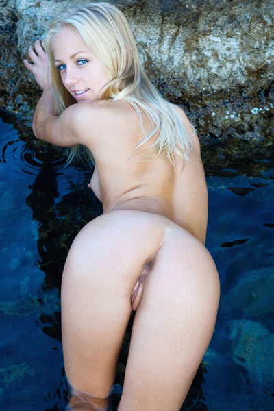 Malisha is impressively nude and incredibly limber as she poses in water