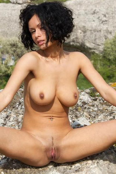 Sexy Lubashka squeezes her big tits while showing her shaved and yummy pussy outdoors
