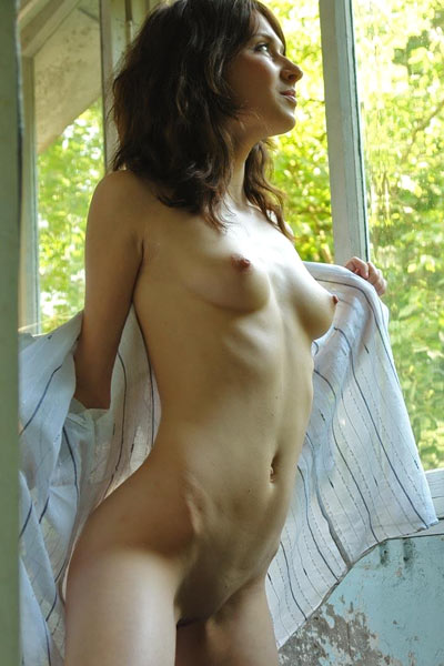 Dary daringly poses in the outer room baring her gorgeous breasts and lithe body