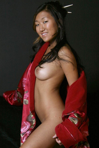 Soo opens her kimono to show her naked body underneath