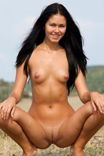 Jubia is completely naked and playing in an open field