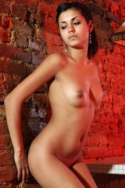 Nasrin goes totally nude and straddles a table to show off her body