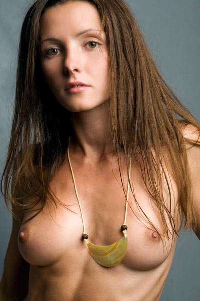 Polinaria A pulls down her shirt to show off her small breasts and skinny body