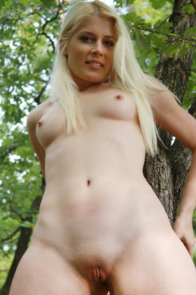Sandik A is naked in the woods and spreading her legs on the ground