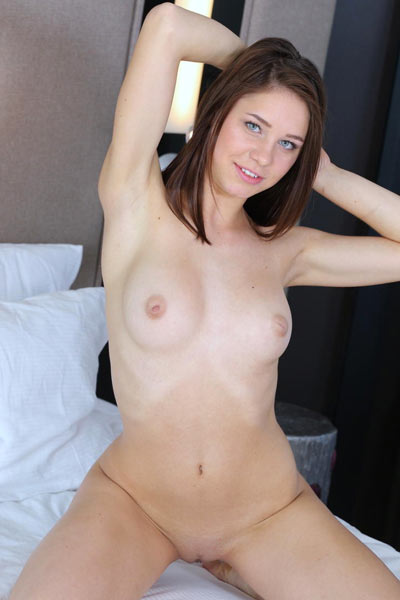 Barbara Vie gets naked in bed and spreads herself wide with her fingers