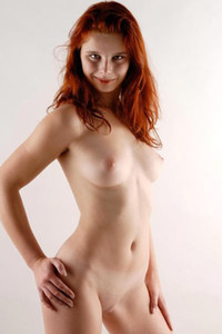 Domestic redhead Margot gets hot and dangerously nude in the kitchen