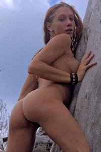 Upshot of very beautiful and very nude Angeli aloft in bare tree