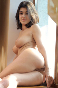 Zita B lay completely nude and spreads her legs by an open window