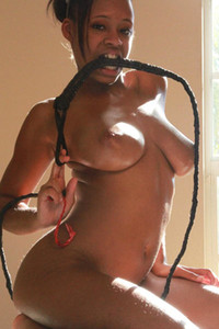 Tierra poses with a whip and wears nothing but a pair of devil horns