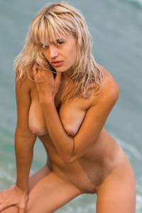 Vika R is naked and jumping around on the beach