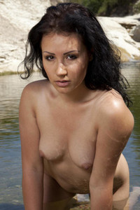 Hot brunette wears white see through shirt and plays in the water