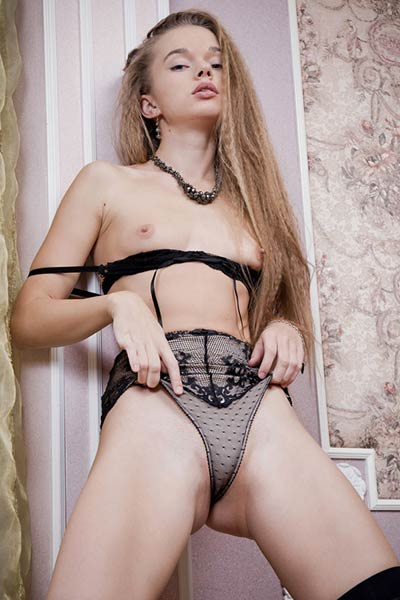 Sexy Milena D has a blast wearing black thigh highs and sexy lingerie