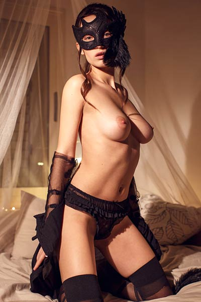 This beautiful mysterious brunette uses a masquerade mask as her sexy prop