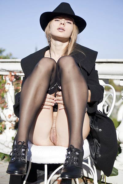 Milena D acts like an exhibitionist showing her perfect body through a black trenchcoat