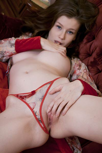 Emily Bloom heats up a sunny room in red knee high stockings and nothing else