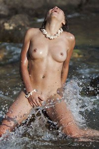 After getting wet in the sea her pussy is wet from posing nude and fingering