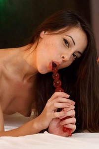Lorena B finds her pleasure in the form of red beads in her holes