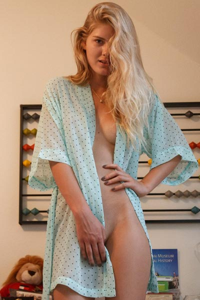 Nola Barry poses in a sheer bathrobe on the bedroom floor