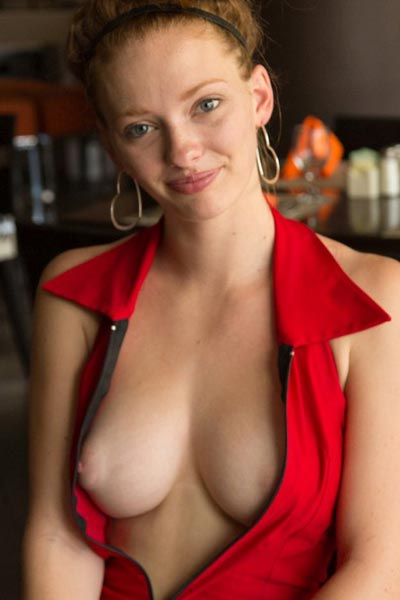 Wendy Patton opens her dress to show her perfect breasts at restaurant table