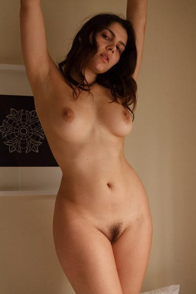 Valentina Nappi gets totally naked in bed and shows off her curvy body