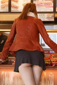 Abby Vissers shows off her panties in public by bending over in short skirt