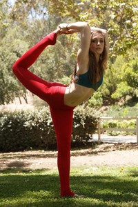 Diana Mackie does her yoga poses in the park wearing tight clothes