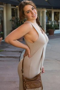 Lanie Morgan pulls her long dress through her legs to show off in grocery store