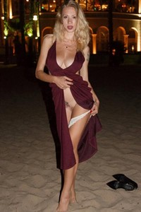 Hot blonde pops her breasts out from her dress in the middle of the club