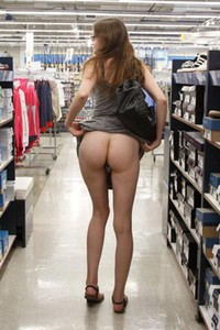 Patience Dolder lifts up her dress in store to show her naked lower half