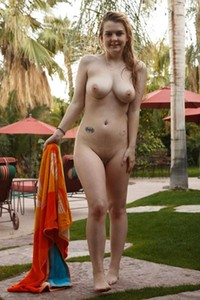 Alyssa Weiber gets naked in the pool before toweling herself off