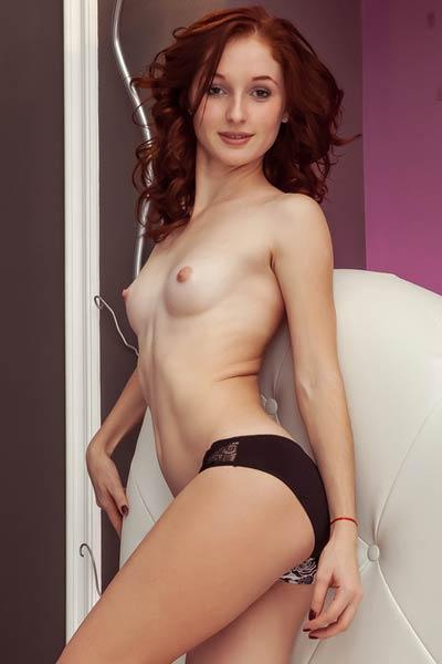 Girl next door Evita poses at home showing off her sweet snatch