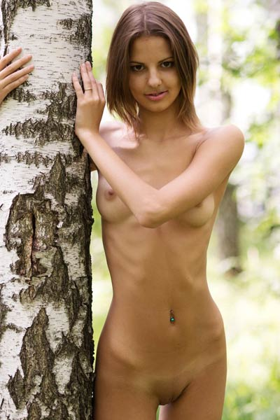 Sultry Sandra shows off her tight ass and juicy pussy in the woods