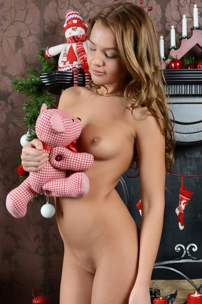 Santa's helper Lina models at Christmas revealing her tight snatch and firm ass