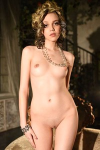 Exotic Lily poses in Renaissance splendor showing her juicy pussy for your pleasure