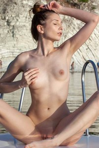 Naughty Niva poses on a boat by the sea showing her delicious snatch
