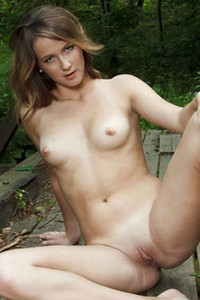 Virgin Alice poses outdoors in the woods showing her snatch and tits