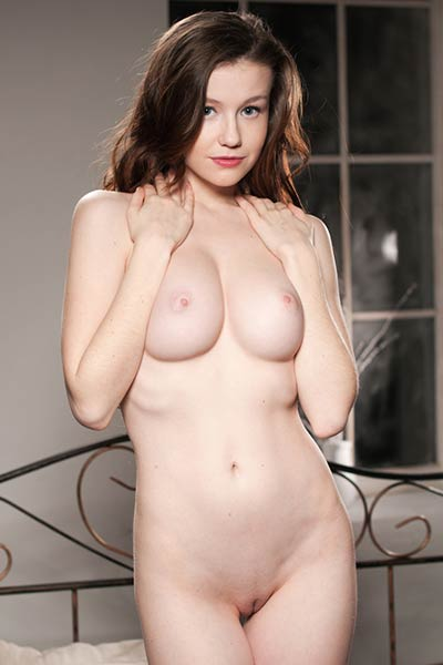 Pale young babe Emily has a good pair of tits that she offers to you