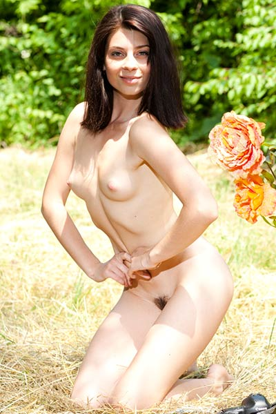 Gorgeous Sandra strips nude outside showing off her boobs and hairy twat