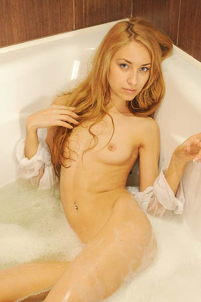 Stunning Elyza gets wet in bath wearing only a sheer white shirt