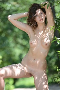 Mari shows her feminine side as she poses naked in front of a camera