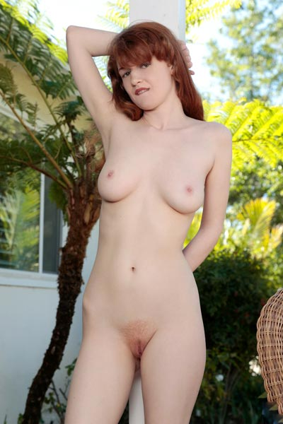 Cute redhead infatuates you by stripping striped dress and fingering her twat outdoors