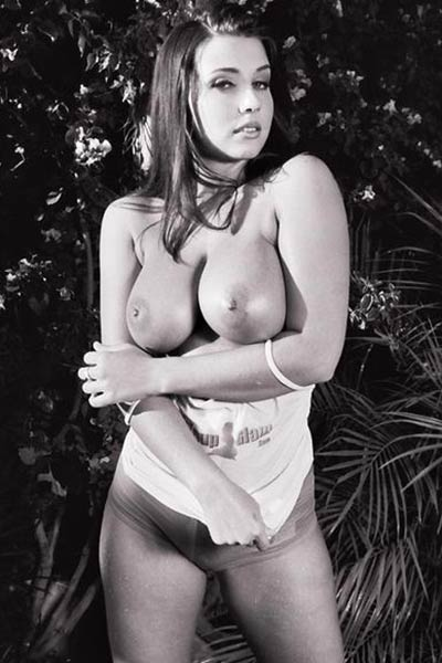 Juicy Erica Campbell strips in a wet t-shirt showing off her huge tits